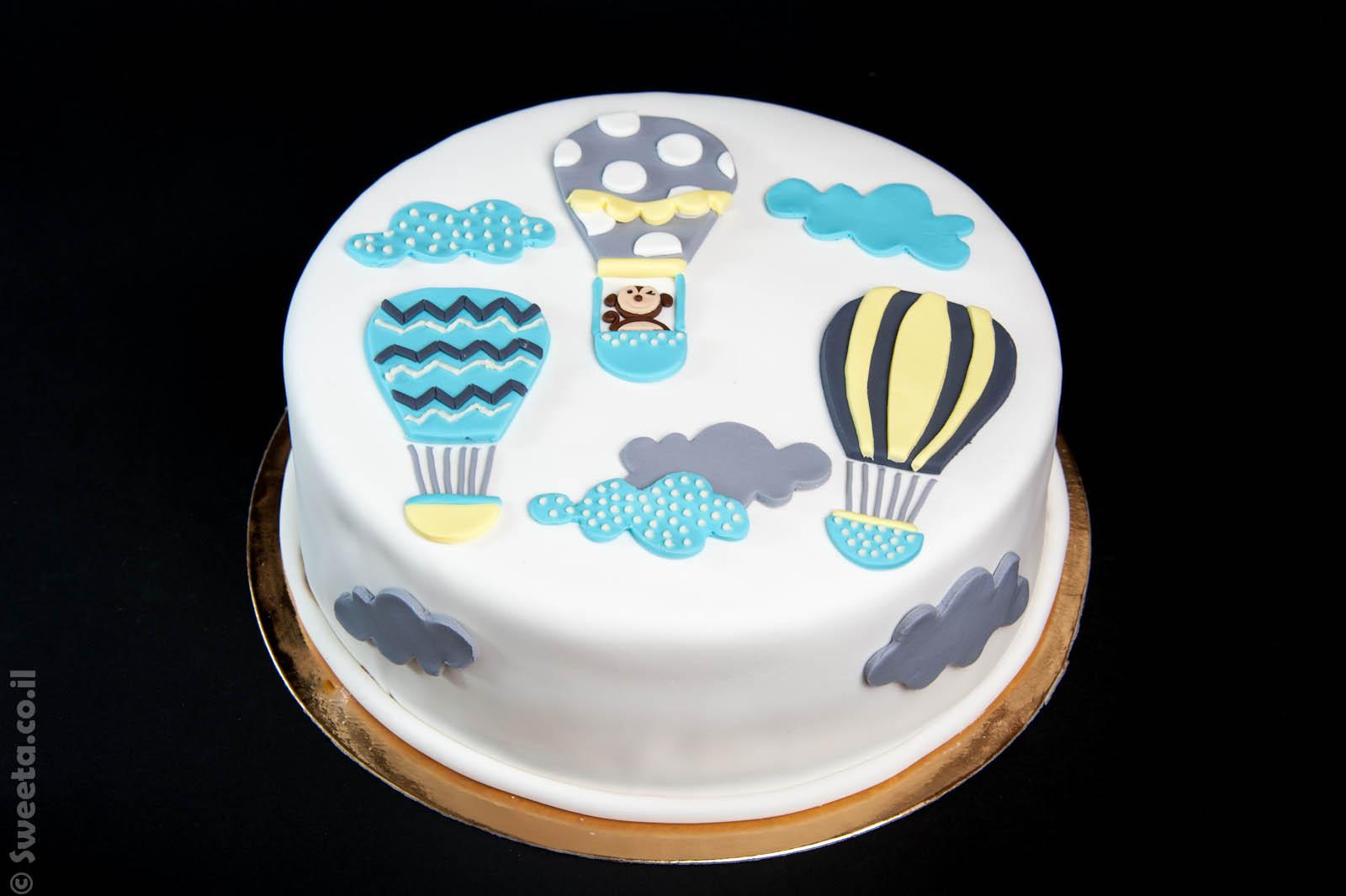 עוגה של כדורים פורחים מעוצבת בבצק סוכר מתנה ליולדת